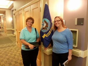 Kathy Cayton and Marty attended the Community Hospice Veterans Partnership meeting today and Kathy took her on a tour of the Sunbeam Road Inpatient facility. This is a picture with the service flags that we have helped purchase, which are displayed outside of each Veteran's room.
