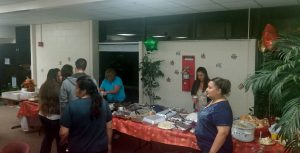 """Members of NWCA Memphis #119 set up for their monthly """"We Care Supper""""."""
