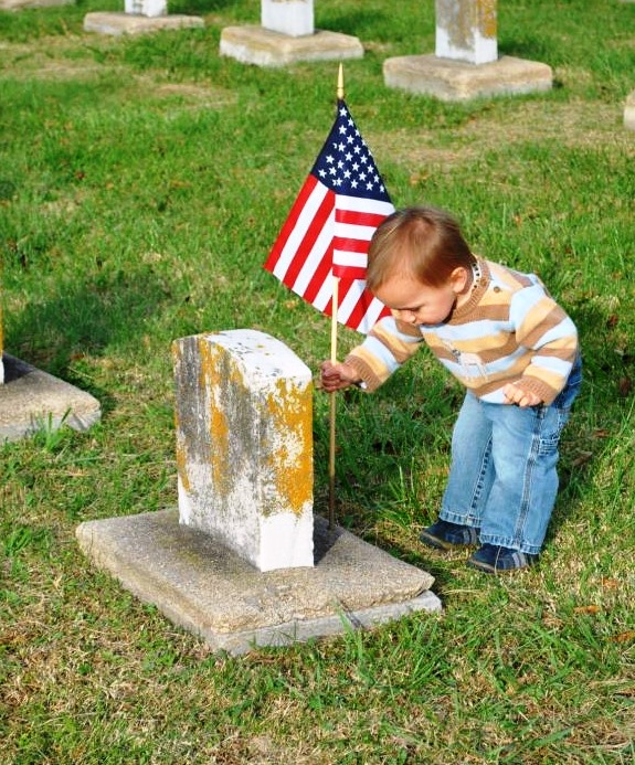 Members of NWCA Portsmouth #221 placed flags on the graves of our veterans.Even the children helped out.