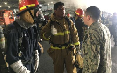 Firefighters from the greater San Diego area battle fire onboard the USS Bonhomme Richard (LHD-6)
